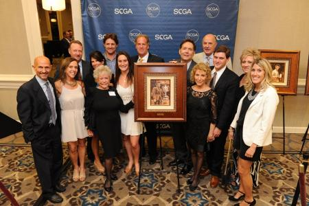 The Kelly family poses with the Roger Kelly portrait