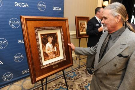 Jeff Runyan admires the portrait of his father, the late Paul Runyan