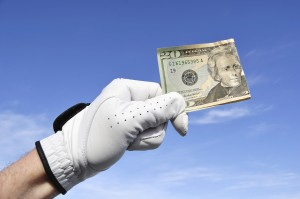 Golfer Wearing Golf Glove Holding a Twenty Dollar Bill