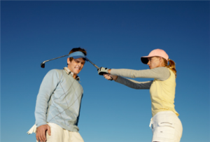 woman-hitting-man-golf-club