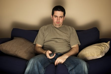 depositphotos_19311839-stock-photo-bored-overweight-man-sits-on
